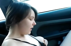 Cute girl masturbates in a car