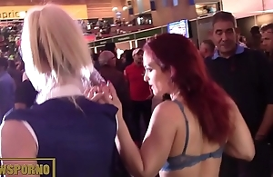 Redhead and blonde public threesome on stairs