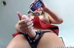 Dominatrix babe spanks subs ass