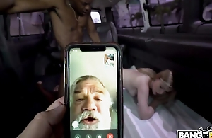 Daddy watches his daughter taking BBC in the bus