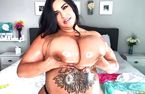 Hot BBW oils her grown boobs and plays with them